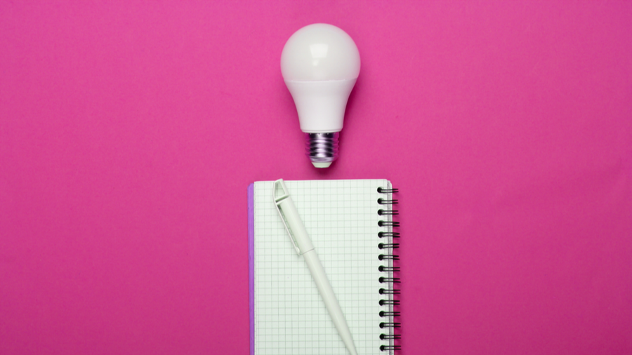 lightbulb and notepad with pen